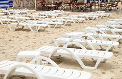Chaises longue on a beach Royalty Free Stock Photography