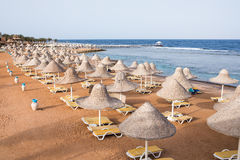 Chaises longues on the beach sea Stock Photography
