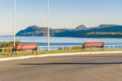 Chaiten Town, Los Lagos, Patagonia, Chile. Empty boardwalk with fjord view at Chaiten town, Patagonia, Chile royalty free stock photo