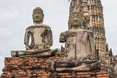 Chaiwatthanaram Temple - Ayutthaya Thailand, Sitting Buddha - A temple in Ayutthaya In the ruins of the royal temple stock photos