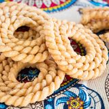 Chakli famous South Indian Traditional Snack. Spiral shaped crisp fried snack. Selective focus. Indian pattern background. Square. Image stock photo