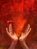 Chakra Fire. Photo based mixed medium images of hands with fire from the red chakra.Located at the base of the spine, this chakra forms our foundation. It Stock Photo