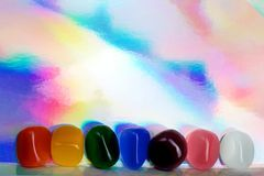 Chakra Healing Stones header rainbow coloured graduated banner copy space above. Top view royalty free stock image