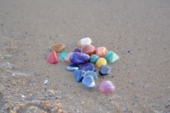 Chakra stones on wet sand Stock Images