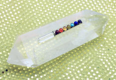 Chakra Wand on Quartz Stone Stock Image