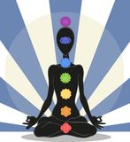 Chakras. Man silhouette in yoga position with the symbols of seven chakras Stock Photo