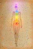 Chakras über einem menschlichen Körper Stockbild