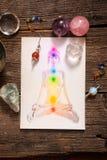 Chakras über einem menschlichen Körper Lizenzfreies Stockfoto