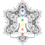 Chakras concept. Silhouette in lotus position over decorative ma. Ndala round pattern with sacred geometry element Metatron Cube, powerful symbol, Flower of Life Stock Photography