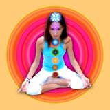 Chakras girl. A young girl meditating with 7 chakras Stock Photos