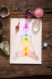 Chakras over a human body. Chakras illustrated over human body with natural crystals and pendulum Royalty Free Stock Photo