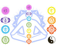 Chakras and spirituality symbols. On man in lotus pose Royalty Free Stock Photography
