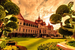 Chakri Maha Prasat or Grand palace in the sunset Stock Photos