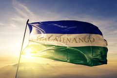 Chalatenango Department of El Salvador flag textile cloth fabric waving on the top sunrise mist fog. Beautiful stock photography