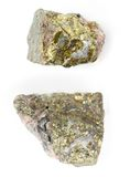Chalcopyrite with inclusions of crystals on a white background. Royalty Free Stock Images