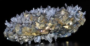 Chalcopyrite, pyrite and calcite. White rock crystal Royalty Free Stock Images