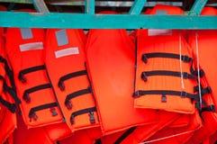 Chalecos salvavidas anaranjados Fotografía de archivo libre de regalías