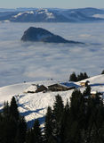 Chalet above clouds in winter Stock Image