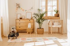Chalet Baby Bedroom Interior with Cozy Cradle Bed. Light Brown Childish Room with Wooden Empty Cot. Cosy Home Hygge Style Design. Beautiful Child Toy in Large stock photos