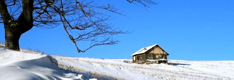 Chalet on blue sky Stock Photography