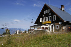 Chalet in Chamrousse. CHAMROUSSE, FRANCE, August 4, 2016 : Chalet du Pere Tasse is the oldest building in the resort of Chamrousse Royalty Free Stock Photos
