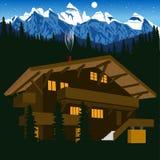 Chalet de madera en las montañas de la montaña en la noche Fotos de archivo libres de regalías