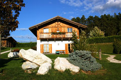 Chalet With Flowers and Wood Stock Photo