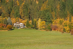 Chalet at foot of mountains Royalty Free Stock Photos