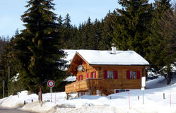 Chalet in Jura mountain Switzerland by winter Royalty Free Stock Photography