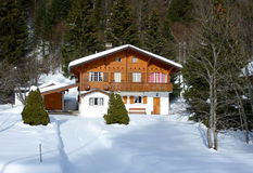 Chalet in Jura mountain, Switzerland, by winter Royalty Free Stock Photography