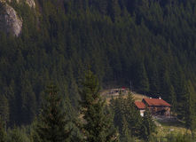Chalet lost in the mountains. Wooden chalet in Romanian mountains Stock Photo
