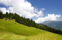 Chalet and mountain landscape Royalty Free Stock Images