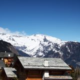 Chalet in mountains Stock Images