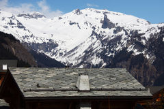 Chalet in mountains Stock Image
