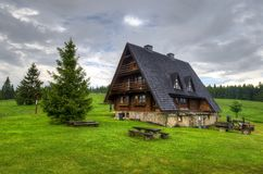 Chalet in mountains. Charming and cosy mountain hostel located on a glade surrounded by forest in Beskids royalty free stock images