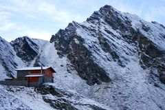 Chalet near Balea Lake surrounded by mountains Stock Image
