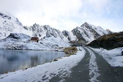 Chalet near Balea Lake and surrounded by mountains Stock Images