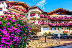 Chalet purple flowers colorful summer south tyrol accomodation. Villandro, Italy, 11 aug 2017 - A chalet building with colorful purple flowers. Classical summer stock image