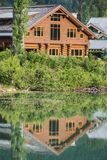 chalet reflected - -whistler-nikon1v2-30-110mm-20150624-DSC_0112.jpg Stock Photo