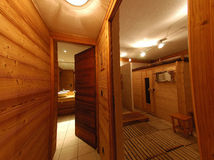 Chalet sauna. Interior of sauna and washroom in holiday chalet royalty free stock image