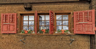 Chalet with shutters red Royalty Free Stock Photos
