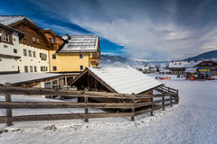 Chalet and ski resort in Austrian Alps covered by snow Stock Photo
