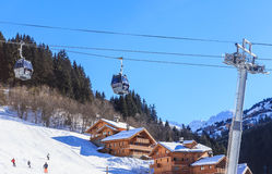 Chalet on the slopes of the valley Meribel. Cabins cableway. Ski Resort Meribel Village Center (1450 m) Royalty Free Stock Images