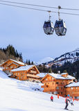 Chalet on the slopes of the valley Meribel. Cabins cableway. Royalty Free Stock Image