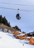 Chalet on the slopes of the valley Meribel. Cabins cableway. Royalty Free Stock Photos