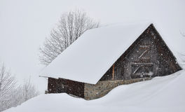 Chalet in the snow. Chalet mountain covered with snow during a snowfall royalty free stock images