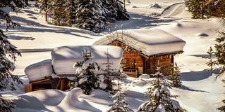 Chalet under the snow Stock Photos