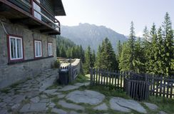 Chalet and view over mountain. Ceahlau mountain, Romania and traditional chalet Stock Photo