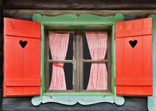 Chalet Window. Colorful Wooden Cottage Chalet Window royalty free stock image