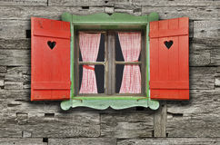 Chalet Window. Colorful Wooden Chalet Window on Weathered Wooden Wall stock images